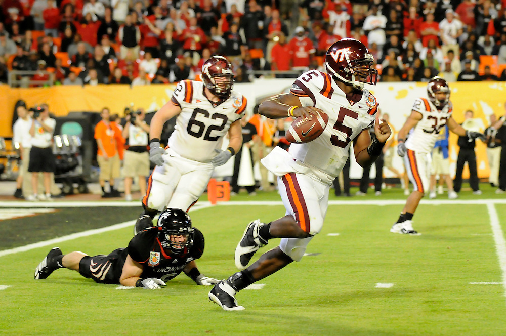 January 1, 2009: Tyrod Taylor of the Virginia Tech Hokies eludes Connor Barwin of the Cincinnati Bearcats during the NCAA football game between the Virginia Tech Hokies and the Cincinnati Bearcats in the Orange Bowl Classic. The Hokies defeated the Bearcats 20-7.