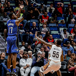 Oct 30, 2017; New Orleans, LA, USA; Orlando Magic forward Jonathon Simmons (17) shoots over New Orleans Pelicans guard E'Twaun Moore (55) during the second half of a game at the Smoothie King Center. The Magic defeated the Pelican 115-99. Mandatory Credit: Derick E. Hingle-USA TODAY Sports
