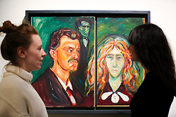"""© Licensed to London News Pictures. 08/04/2019. London, UK. Staff member view Edvard Munch's """"Self-portraits with Tulla Larsen, about 1905"""". Munch met Tulla Larsen in Kristiania, and they became engaged in 1898. Judging from their expressions, and the curious dark figure in the background, the painting was probably done after the couple finally separated. This followed a shooting incident in 1902, which left Munch with a permanently damaged hand. Munch cut the painting into two when the relationship ended. <br /> <br /> The work of Norwegian artist Edvard Munch (1863-1944) - """"Edvard Munch: love and angst"""" at the British Museum opens from 11 April until 21 July 2019. The exhibition focus on Munch's remarkable and experimental prints – an art form which made his name and at which he excelled throughout his life – and will examine his unparalleled ability to depict raw human emotion. It will be the largest exhibition of Munch's prints in the UK for 45 years. Photo credit: Dinendra Haria/LNP"""