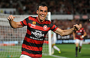 01.01.2014 Sydney, Australia.Wanderers forward Mark Bridge scores during the Hyundai A League game between Western Sydney Wanderers FC and Wellington Phoenix FC from the Pirtek Stadium, Parramatta. Wellington won 3-1.