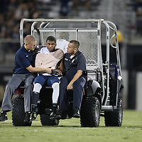 ORLANDO, FL - OCTOBER 09:  Jordan Johnson #6 of the Brigham Young Cougars leaves the field on a cart after an injury at Bright House Networks Stadium on October 9, 2014 in Orlando, Florida. (Photo by Alex Menendez/Getty Images) *** Local Caption *** Jordan Johnson