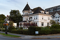 Huntingdon Manor in Victoria BC in decorated with small white lights in the early evening light.