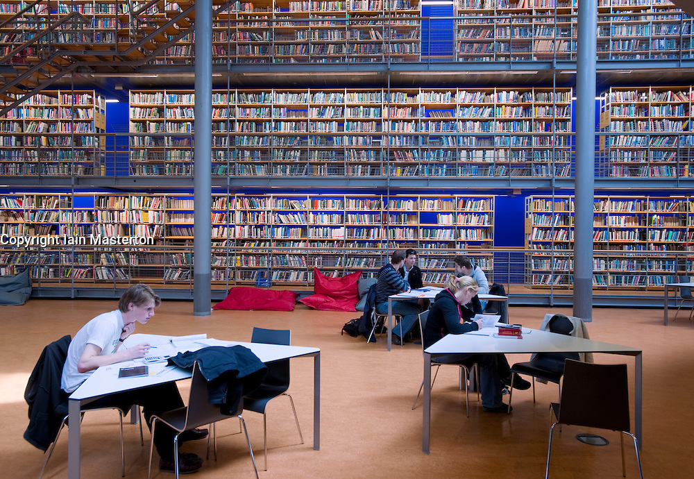 Students working inside modern library at Technical University in Delft,The Netherlands. Architect Mecanoo