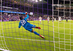April 21, 2018 - Orlando, FL, U.S. - ORLANDO, FL - APRIL 21: San Jose Earthquakes goalkeeper Andrew Tarbell (28) saves a PK during the MLS soccer match between the Orlando City FC and the San Jose Earthquakes at Orlando City SC on April 21, 2018 at Orlando City Stadium in Orlando, FL. (Photo by Andrew Bershaw/Icon Sportswire) (Credit Image: © Andrew Bershaw/Icon SMI via ZUMA Press)