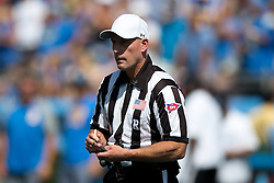 PASADENA, CA - SEPTEMBER 05:  College football referee Jerry Magallanes stands on the field during the third quarter between the UCLA Bruins and the Virginia Cavaliers at the Rose Bowl on September 5, 2015 in Pasadena, California.  The UCLA Bruins defeated the Virginia Cavaliers 34-16. (Photo by Jason O. Watson/Getty Images) *** Local Caption *** Jerry Magallanes