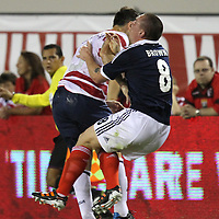 United States Defenseman Carlos Bocanegra (3) checks Scotland Midfielder Scott Brown (8) during an international friendly soccer match between Scotland and the United States at EverBank Field on Saturday, May 26, 2012 in Jacksonville, Florida.  The United States won the match 5-1 in front of 44,000 fans. (AP Photo/Alex Menendez)