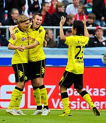 29.08.2010, Mercedes-Benz Arena, Stuttgart, GER, 1. FBL, VfB Stuttgart vs Borussia Dortmund, im Bild vl. Marcel Schmelzer (Dortmund #29), Kevin Grosskreutz (Dortmund #19), Shinji Kagawa (Dortmund #23) bejubeln das 0:1, EXPA Pictures © 2010, PhotoCredit: EXPA/ nph/  Roth+++++ ATTENTION - OUT OF GER +++++ / SPORTIDA PHOTO AGENCY