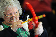 BEA AHBECK/NEWS-SENTINEL<br /> Inez Saulkner takes aim during the try-out for the Vienna Nursing &amp; Rehabilitation Center's own 2016 Summer Olympic competition as festivities start at the Lodi facility Thursday, Aug. 4, 2016.