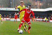 Crawley Town forward Karlan Ahearne-Grant keeps the ball from Cheltenham Town defender Taylor Moore (28) during the EFL Sky Bet League 2 match between Crawley Town and Cheltenham Town at the Checkatrade.com Stadium, Crawley, England on 24 March 2018. Picture by Andy Walter.