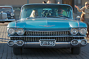 During summer from June to Septemper, every first Friday of the month is Vintage Car Cruising Night. Hundreds of classic American cars cruise around downtown Helsinki and meet at special places to have a good time, here at Kauppatori (Market Square). A proud couple with their 1959 Cadillac DeVille sedan.