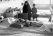 Burned boy and his family in the Saddam Central Hospital in Baghdad.. There is no food or medicine available in the hospital, a situation blamed on the UN Sanctions against Iraq.  Burns are kept clean, but there is no pain medication. All food must be brought from home.