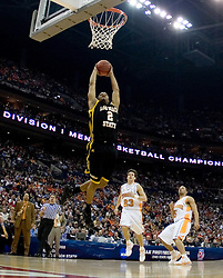 Long Beach State 49ers guard Louis Darby (2) goes up for a dunk against Tennessee.  The #5 seed Tennessee Volunteers defeated the #12 seed Long Beach State 49ers 121-86  in the first round of the Men's NCAA Tournament in Columbus, OH on March 16, 2007.