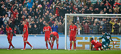 SWANSEA, WALES - Sunday, May 1, 2016: Liverpool players look dejected as Swansea City score the third goal during the Premier League match at the Liberty Stadium. (Pic by David Rawcliffe/Propaganda)