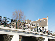 Looking up towards a bridge over one of Amsterdam's many canals.