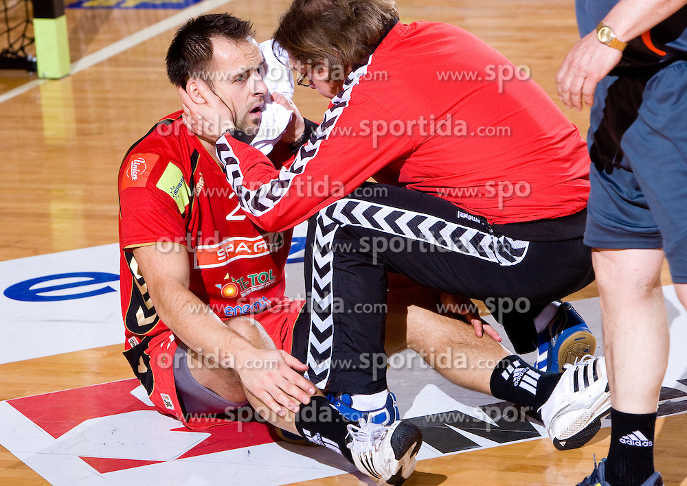Boris Becirovic of Slovan and physiotherapist Gorazd Zuzek during the 1/ 8 Men's European Handball Challenge Cup match between RD Slovan, Slovenia and Ystads IF, Sweden, on February 21, 2009 in Arena Kodeljevo, Ljubljana, Slovenia. Slovan defeated Ystads 37-27 and qualified to quarterfinals. (Photo by Vid Ponikvar / Sportida)