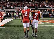 The Big 12 College football championship game, Nebraska vs. Texas at Cowboys Stadium in Arlington, Texas 5 December, 2009. Nebraska's Antonio Bell (2), and Dejon Gomes leave the field after a last second 13-12, loss to Texas Saturday, December 5, 2009 at Cowboys Stadium.