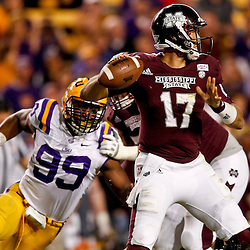 November 10, 2012; Baton Rouge, LA, USA; Mississippi State Bulldogs quarterback Tyler Russell (17) is pressured by LSU Tigers defensive end Sam Montgomery (99) during the second half of a game at Tiger Stadium.  LSU defeated Mississippi State 37-17. Mandatory Credit: Derick E. Hingle-US PRESSWIRE