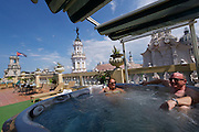 Havana, Cuba. Hotel Inglaterra. Gran Teatro de la Habana behind the whirlpool at the rooftop terrace.