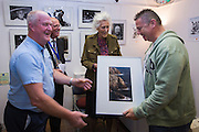 Adrian Bishop CPAGB (far R) receives 'Best in Exhibition' from Grace Robertson, President of the Seaford Photographic Society looked on by Steve Gardner, Chair of the SPS with Vice Chair Colin Bell<br /> <br /> Opening of the Seaford Photographic Society Exhibition 2016 by former Photo-journalist for Picture Post Grace Robinson. The exhibition will be open 1000-1700 everyday from 13-25 August 2016. Admission free