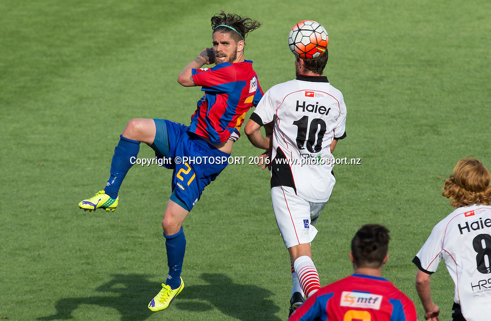 WaiBOP midfielder Sean Morris heads ball away from Canterbury United's Gary Ogilvie during the ASB Premiership - Round 11 football match won by Canterbury 3-2, at FMG Stadium, Hamilton, Sunday 7 February 2016. Copyright Photo: Stephen Barker / www.photosport.nz