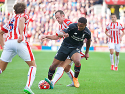 STOKE-ON-TRENT, ENGLAND - Sunday, August 9, 2015: Liverpool's Jordon Ibe in action against Stoke City's Charlie Adam during the Premier League match at the Britannia Stadium. (Pic by David Rawcliffe/Propaganda)