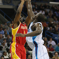 Jan 02, 2010; New Orleans, LA, USA; Houston Rockets forward Carl Landry (14) shoots over New Orleans Hornets center Emeka Okafor (50) during the first quarter at the New Orleans Arena. Mandatory Credit: Derick E. Hingle-US PRESSWIRE