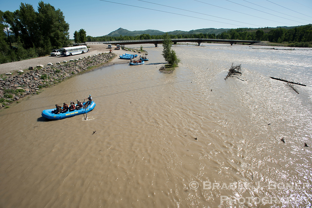 Rafts set out for scenic floats on the Snake River from the Wilson Boat Launch during high runoff last week. River levels peaked over the weekend before dropping during colder weather early this week.