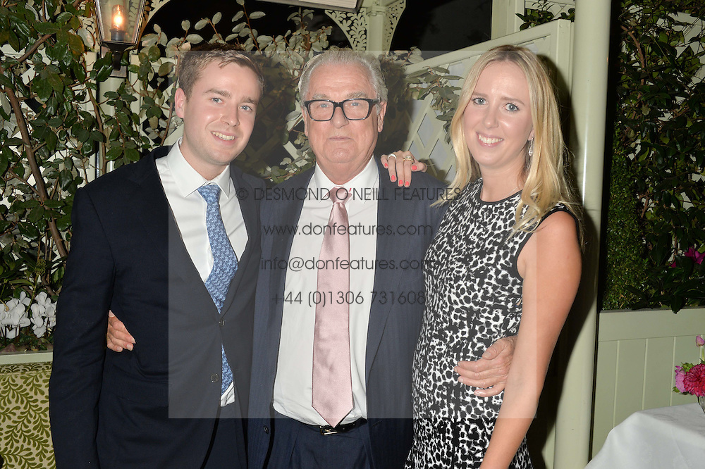 Left to right, HARRY BELL, LORD BELL and DAISY BELL at a party to celebrate the publication of Right or Wrong: The Memoirs of Lord Bell held at Mark's Club, Charles Street, London on 16th October 2014.