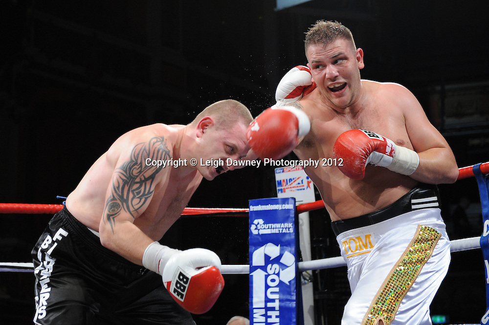 Tom Little (white shorts) defeats Igoris Borucha in a 4x3min heavyweight contest at Olympia, Liverpool on the 21st January 2012. Frank Maloney Promotions on Skysports HD1. © Leigh Dawney Photography 2012.