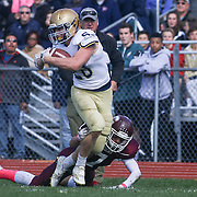 Salesianum Running Back Colby Reeder (28) is tripped up by Concord defensive back Luis Echevarria (7) Saturday, Oct. 17, 2015 at Concord Stadium in Wilmington.