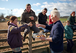 © Licensed to London News Pictures. 10/03/2012..Cleveland, England..Spectators watching the Cleveland Hunt enjoy the traditional tipple as the riders prepare to leave Thrushwood Farm on Teesside at the start of the hunt...Photo credit : Ian Forsyth/LNP