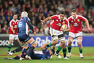 Toby Faletau (Lions) avoids a tackle from Laurie Weeks (Rebels) during the tour match of the 2013 British And Irish Lions Australian Tour between RaboDirect Melbourne Rebels vs British And Irish Lions at AAMI Park, Melbourne, Victoria, Australia. 25/06/0213. Photo By Lucas Wroe