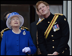 HM The Queen with Prince Harry watch the fly past on the Balcony of Buckingham Palace during Trooping The Colour, London, United Kingdom,<br /> Saturday, 15th June 2013<br /> Picture by Andrew Parsons / i-Images