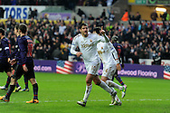 Swansea city's Danny Graham (l) celebrates after he scores his sides 2nd goal to make it 2-2.  FA cup with Budweiser, 3rd round match, Swansea city v Arsenal at the Liberty Stadium in Swansea, South Wales on Sunday  6th Jan 2013. pic by Andrew Orchard, Andrew Orchard sports photography,