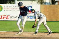 KELOWNA, BC - JULY 24: Nick DiCarlo #16 of the Yakima Valley Pippins reaches to tag a safe Matt Voelzke #5 of the Kelowna Falcons after sliding into second base at Elks Stadium on July 24, 2019 in Kelowna, Canada. (Photo by Marissa Baecker/Shoot the Breeze)