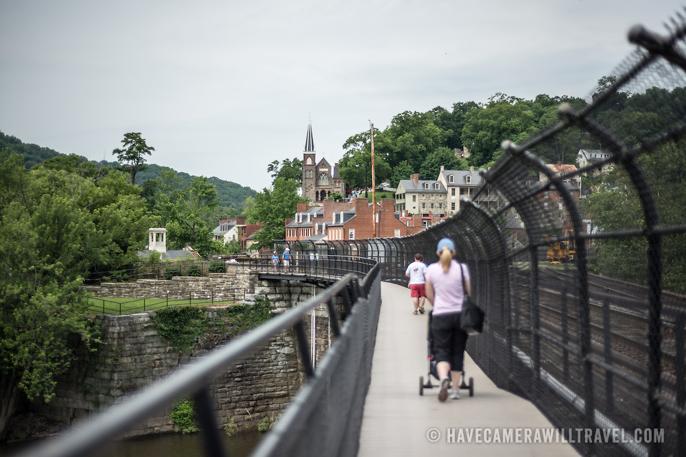 A public walkway along a disused railway bridge across the Potomac in Harpers Ferry, West Virginia. Looking west, towards the town.