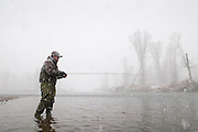 An angler, Steve Warmann, fly fishes during a snowstorm on the South Fork of the Snake River, Idaho.