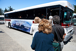 Tourists board a bus up to Hearst Castle, California, United States of America