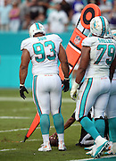 Miami Dolphins defensive tackle Ndamukong Suh (93) watches as the officials measure for a first down during the 2015 week 13 regular season NFL football game against the Baltimore Ravens on Sunday, Dec. 6, 2015 in Miami Gardens, Fla. The Dolphins won the game 15-13. (©Paul Anthony Spinelli)
