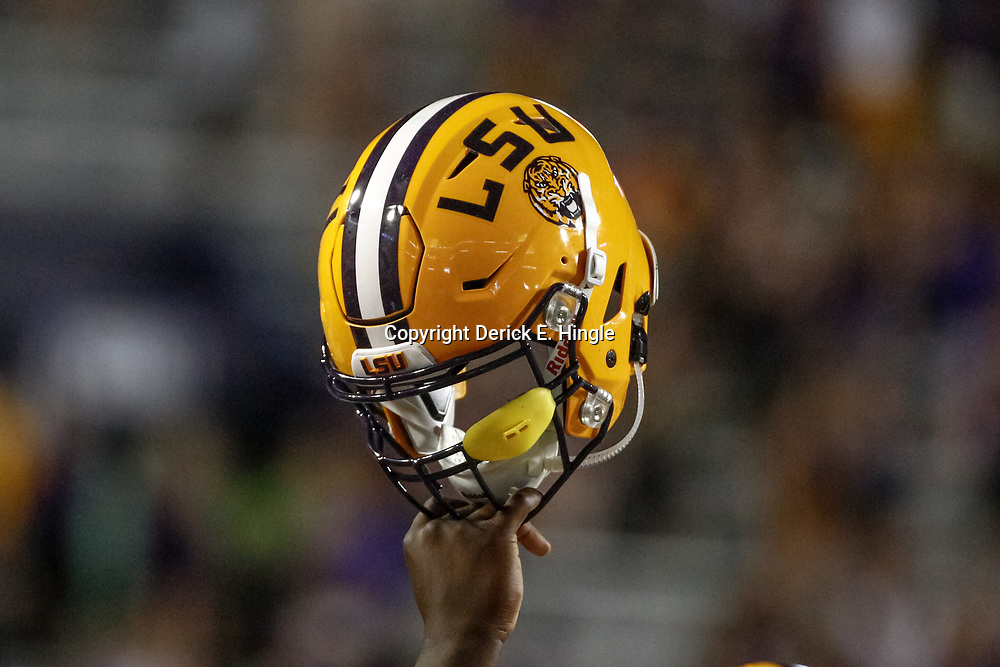Sep 23, 2017; Baton Rouge, LA, USA; A LSU Tigers players holds his helmet in the air during the fourth quarter of a game against the Syracuse Orange at Tiger Stadium. LSU defeated Syracuse 35-26. Mandatory Credit: Derick E. Hingle-USA TODAY Sports