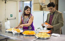 Image ©Licensed to i-Images Picture Agency. 07/03/2015. London, United Kingdom. Ravi Bhanot and family, Conservative Party supporters in Ilford. Ravi and his wife Sushma preparing traditional Indian food at their local Hindu temple in Ilford. Picture by Daniel Leal-Olivas / i-Images