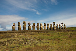 Chile, Easter Island: Array of statues or moai on a platform or ahu at Ahu Tongariki, near the quarry Rano Raruku.  This is the largest array of moia on Easter Island, consisting of 15 moai..Photo #: ch241-32721.Photo copyright Lee Foster www.fostertravel.com lee@fostertravel.com 510-549-2202