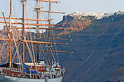 The Sea Cloud moored below Thira at sunrise.