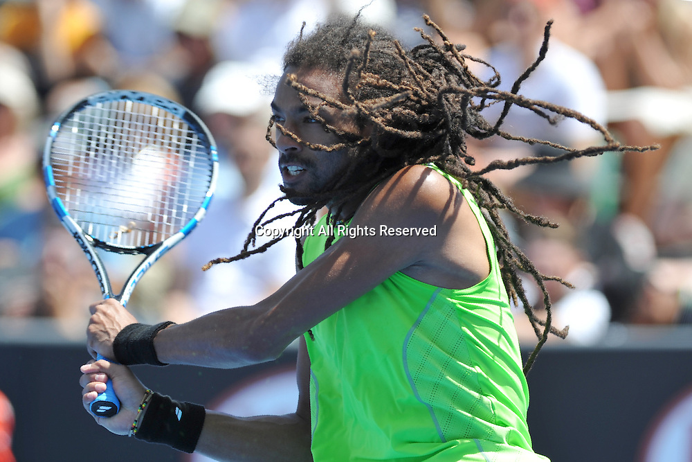 19.01.2015 Australian Open Tennis from Melbourne Park. Dustin Brown of Germany hits a shot in his match against Grigor Dimitrov of Bulgaria on day one of the 2015 Australian Open at Melbourne Park, Melbourne, Australia.