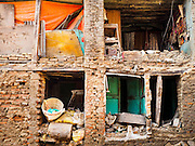 02 MARCH 2017 - SANKHU, NEPAL: A home shorn in half by the 2015 earthquake in Nepal hasn't been repaired yet. There is more construction and rebuilding going on in Sankhu, west of central Kathmandu, than in many other parts of the Kathmandu Valley nearly two years after the earthquake of 25 April 2015 that devastated Nepal. In some villages in the Kathmandu valley workers are working by hand to remove ruble and dig out destroyed buildings. About 9,000 people were killed and another 22,000 injured by the earthquake. The epicenter of the earthquake was east of the Gorka district.   PHOTO BY JACK KURTZ