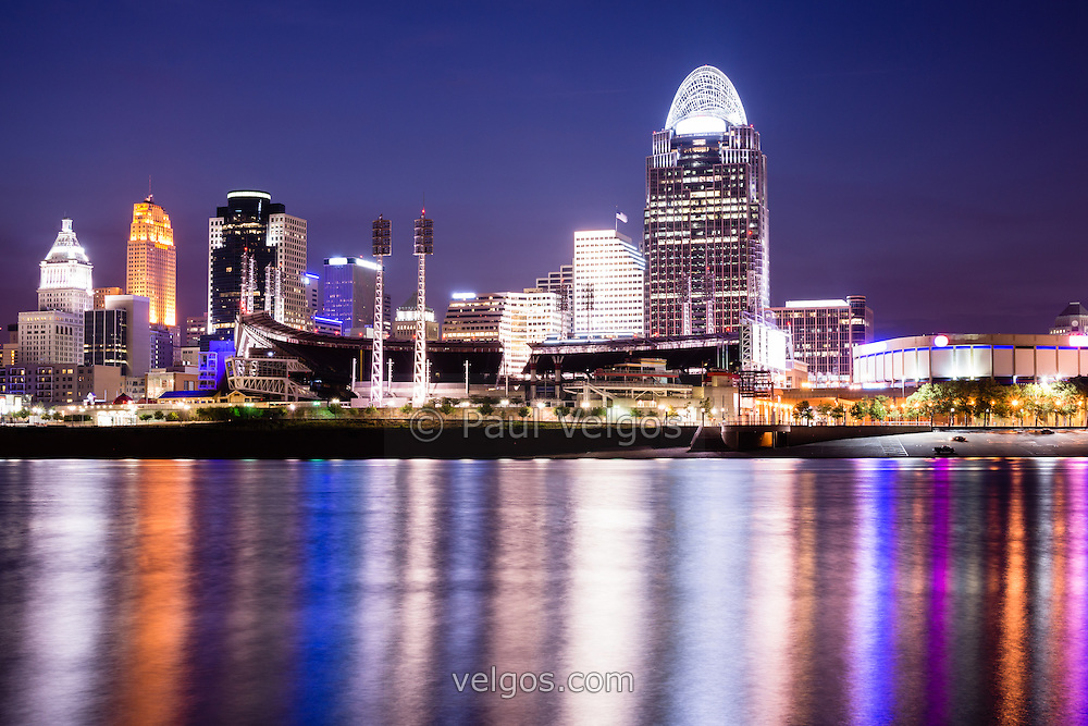 Cincinnati at night with downtown city office buildings including Great American Ballpark, Great American Insurance Group Tower, PNC Tower building, Omnicare building, US Bank building, Carew Tower building, Scripps Center building, and Fifth Third building. Photo was taken in July 2012.