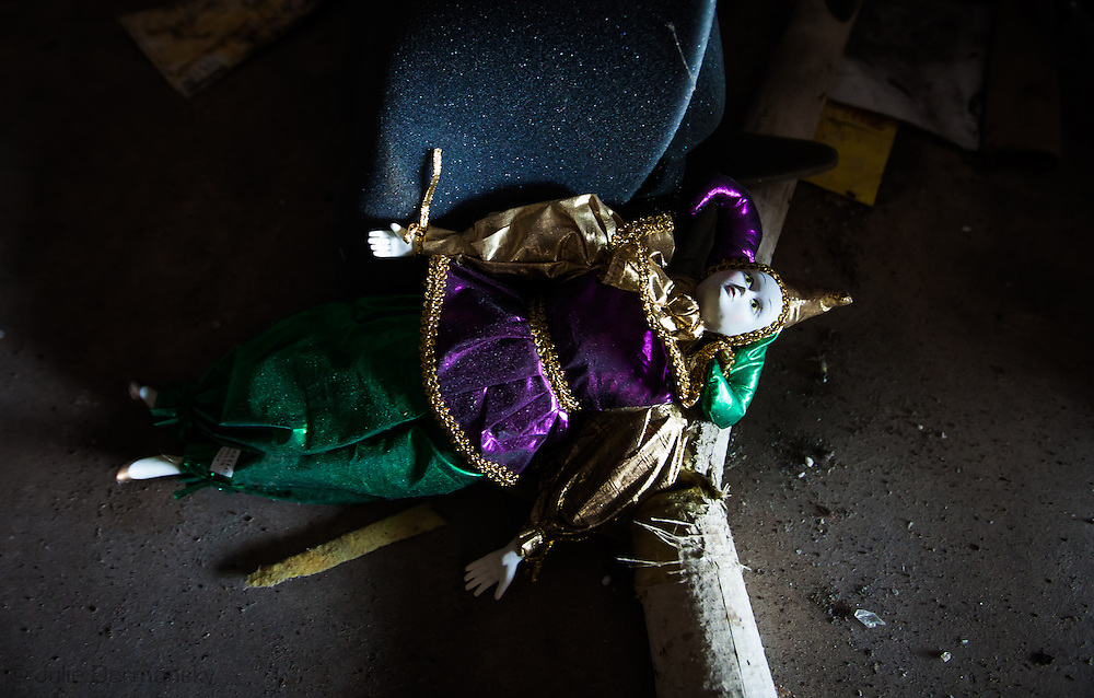 Mardi Gras doll on the floor in a stock room in an abandoned build at Six Flags in New Orleans. Six Flags New Orleans amusement park in Eastern New Orleans, Louisiana, closed since Hurricane Katrina  in 2005 remains in a sate of ruin. The remains of Six Flags amusement park are on low lying land owned by the city of New Orleans and have not be redeveloped since Katrina. on the floor in a stock room in an abandoned build at Six Flags in New Orleans. Six Flags New Orleans amusement park in Eastern New Orleans, Louisiana, closed since Hurricane Katrina  in 2005 remains in a sate of ruin. The remains of Six Flags amusement park are on low lying land owned by the city of New Orleans and have not be redeveloped since Katrina.