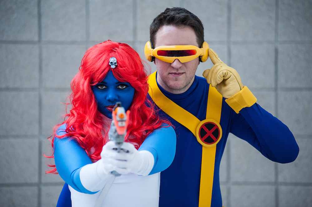 London, UK - 15 March 2014: Sarah Samba as Mystique from X-men and Paul Murray as Cyclops  pose for a picture during the London Super Comic Con at Excel.