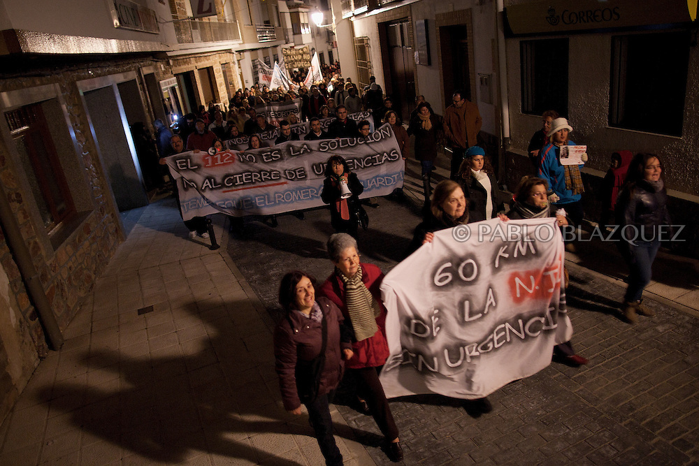 People rally and shout slogans on their way towards the local healthcare centre which closes at 8pm tonight its emergency hours on January 14, 2013 in Tembleque, near Toledo, Spain. A total of 21 centres, specially in rural areas, in the region of Castilla-La Mancha, are eliminating emergency hours services following budget cuts and privatisations in Spanish health services.