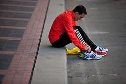 2012 USA Olympic Marathon Trials: marathoner changing into racing flats during warmup